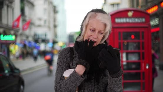 Thumbnail for Senior woman on vacation in London waiting for rideshare with cell phone