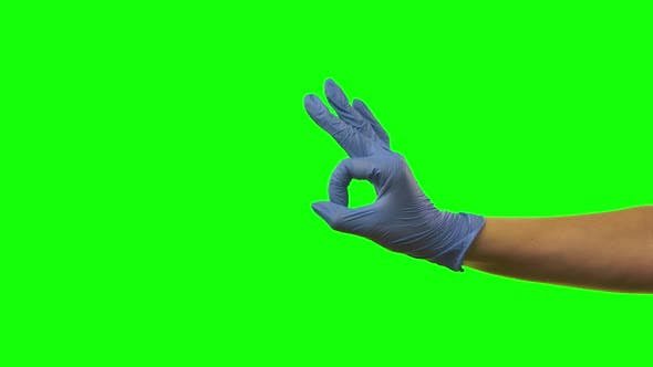 Thumbnail for Doctors Female Hand in Blue Glove Is Making Gestures Ok. Green Screen. Close Up