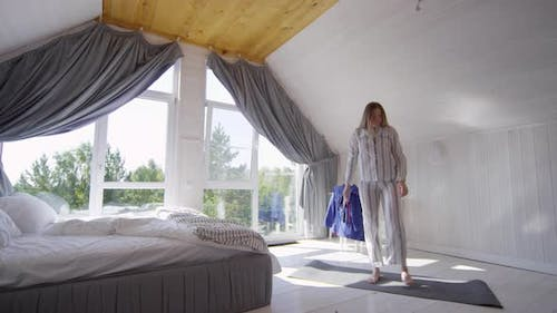 Woman in Pajama Stretching in Morning
