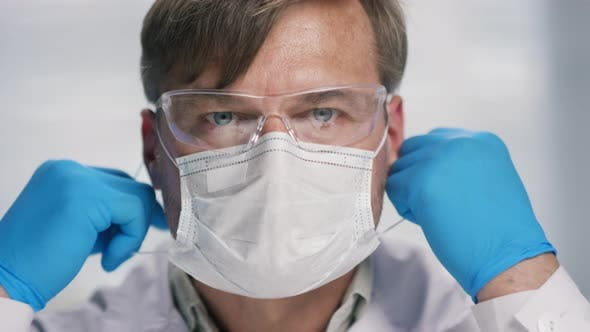 Thumbnail for Portrait of Male Biomedical Scientist Taking off Face Mask