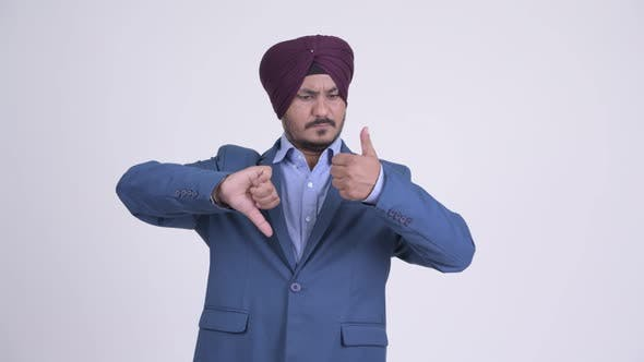 Thumbnail for Confused Bearded Indian Sikh Businessman Making Decisions