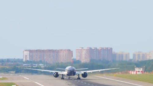 Passenger Plane on the Runway Rear View
