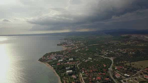 Thumbnail for - Flying Over the Town on Coast. View with Overcast Sky, Greece