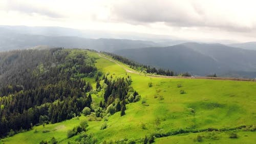 Aerial Drone View: Fabulous View of the Carpathian Mountains in Ukraine, The Mountain Tops Are