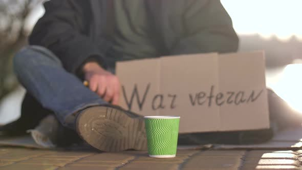 Thumbnail for Legs and Hands of Begging War Veteran