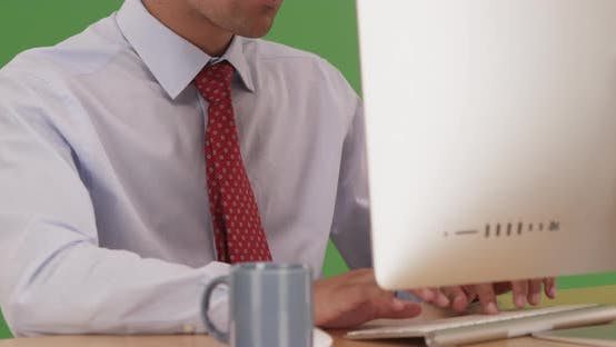 Thumbnail for Close up of Businessman typing on computer keyboard at desk on green screen