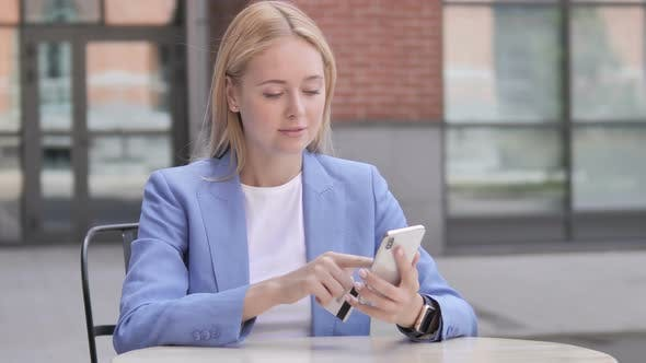 Thumbnail for Online Shopping by Young Businesswoman on Smartphone