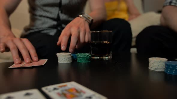 Thumbnail for Close Up of Hands with Playing Cards and Chips on Table.