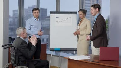 Business People Discussing Startup Project in Office at Whiteboard with Diagram