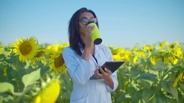 Thumbnail for Agricultural Scientist Taking Coffee Break in Field