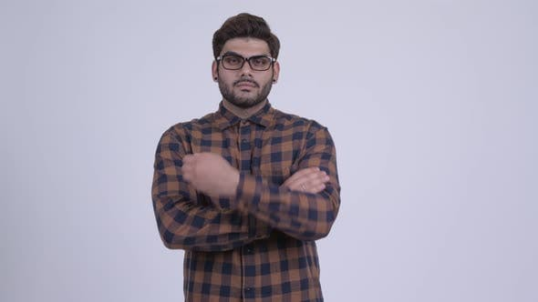 Thumbnail for Happy Young Bearded Indian Hipster Man with Arms Crossed