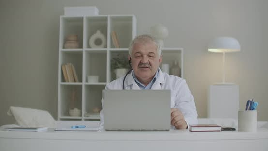 Medical Practitioner Is Working Remotely During Pandemic of Coronavirus, Consulting Online By