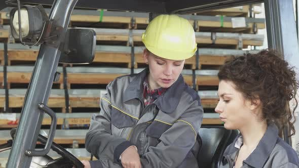 Thumbnail for Female Forklift Operator Talking To Her Colleague While Working