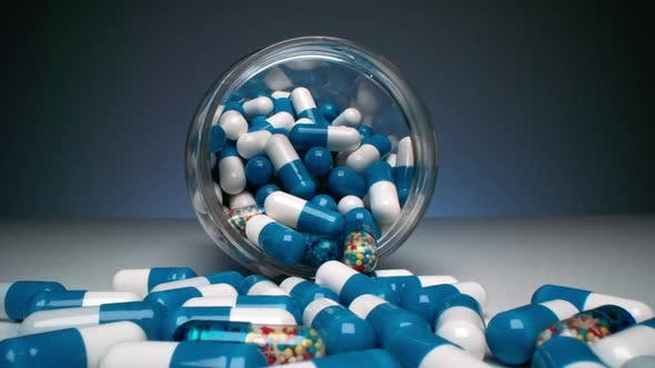 Colorful Capsule Pills In Bottle