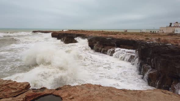 Thumbnail for High Wave Breaking on the Rocks of the Coastline.