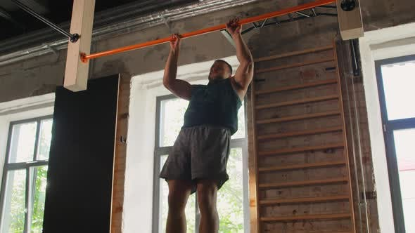 Thumbnail for Man Exercising on Bar and Doing Pull-ups in Gym