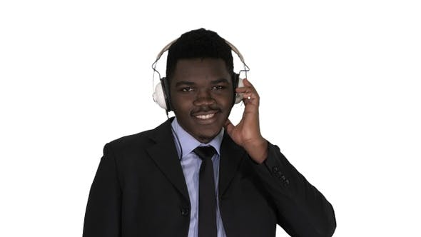 Thumbnail for Afro American businessman in headphones is listening