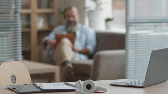 Man with Headset Having Video Call
