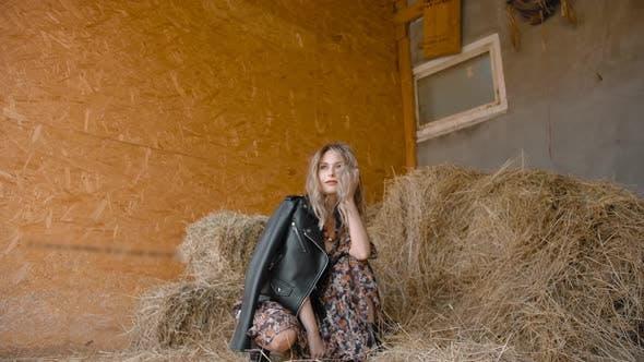 Thumbnail for Dreamy Woman Sitting Near Hay