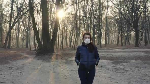 Thumbnail for Portrait of Pregnant Woman in Face Gas Mask in the Woods. Toxic Smoke or Fog in the Forest at Sunset