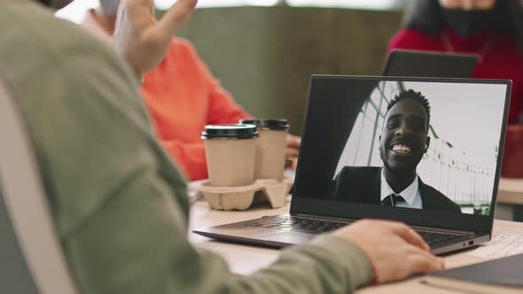Businessman Talking on Video Call with Colleague