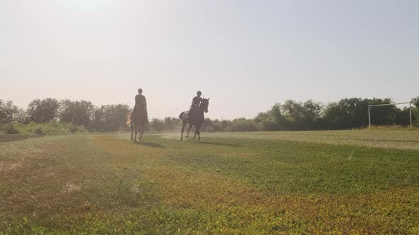 Training of Two Horse Riders Preparing for Racing