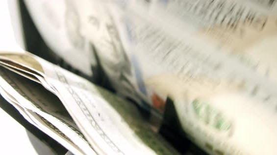 Währungszählmaschine Zählen Dollar-Banknoten