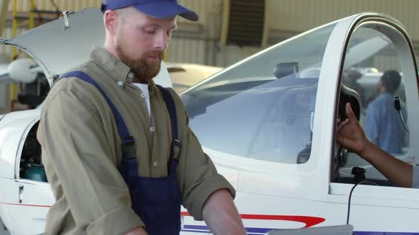 Thumbnail for Male Pilot Talking to Aircraft Mechanic