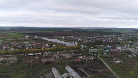 Thumbnail for Aerial view of village and farm