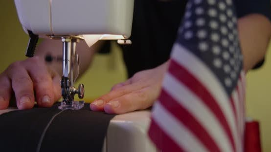 Thumbnail for Tailor Sewing Next to an American Flag 30b