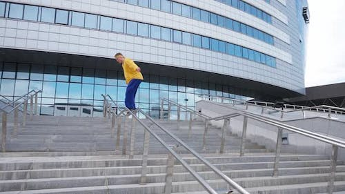 Parkour Young Guy Performs a Backflip Over Obstacles in the City and Doing a Flip on Training Area