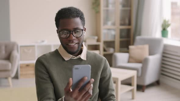 Young African Man Making Video Call Using Smartphone