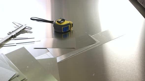 Caliper and Tape Measure.