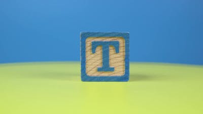 "Close up shot letter ""T"" alphabet wooden block"