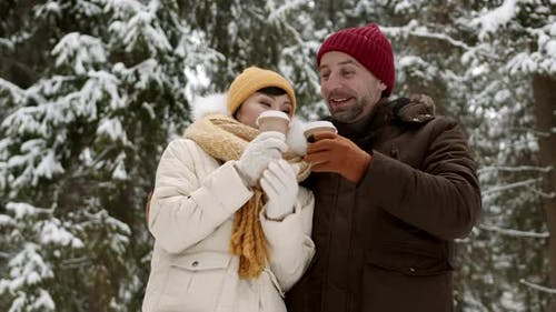 Couple Having Hot Beverage in Winter