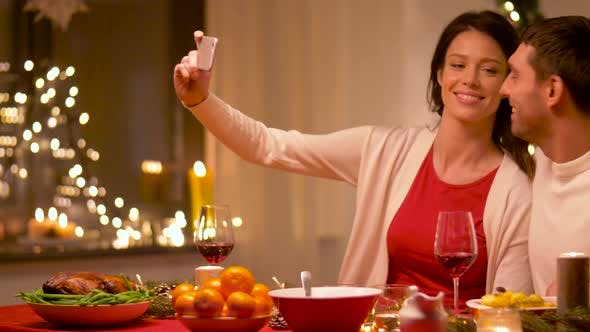 Thumbnail for Couple Taking Selfie at Home Christmas Dinner