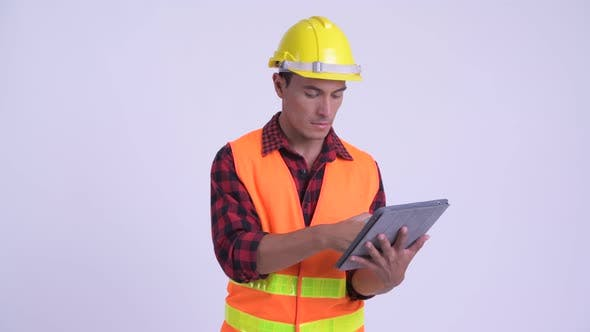Thumbnail for Young Happy Hispanic Man Construction Worker Using Phone and Digital Tablet