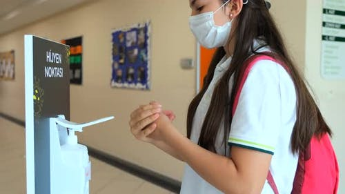 Girl Student Using Sanitize Coronavirus