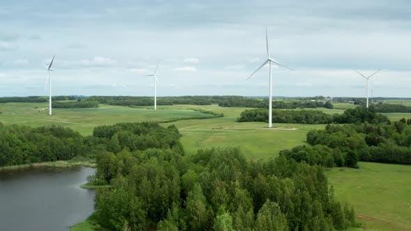 Thumbnail for Drone Shot of Windmills Turbine Among Fields