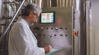 Scientist in white coat taking notes