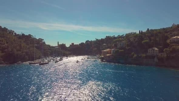 Portofino, Italy, Vessels Move Through Strait Near Coastal Town at Summer Sunny Day