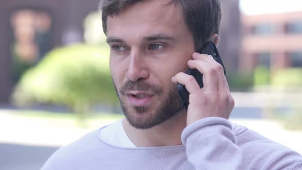 Thumbnail for Handsome Man Talking on Phone, Negotiating in Good Mood