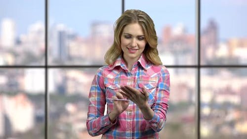 Woman Using Futuristic Tablet Pc