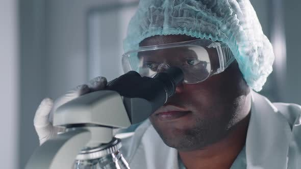 Thumbnail for Medical Scientist With Microscope