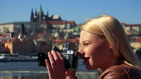 Thumbnail for A Young Attractive Woman Takes Photos with a Camera - Face Closeup From the Side