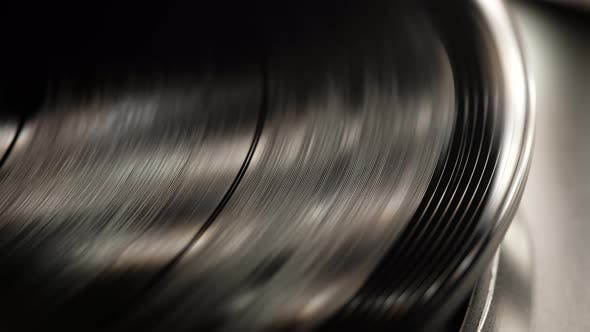 Cover Image for Retro-styled Spinning Record Vinyl Player. Close Up. Rotating Vintage Phonograph Close Up. Beautiful
