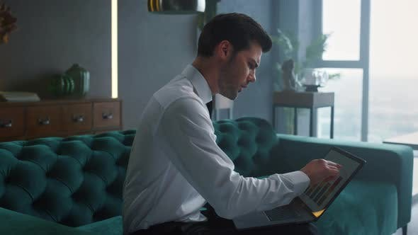 Thumbnail for Businessman Analyzing Business Graphs on Laptop Screen, Worker Using Laptop