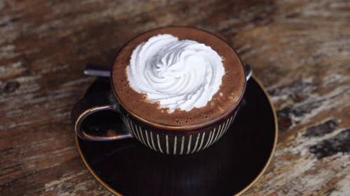 Top View of a Cup of Dairy Free Hot Chocolate with Cream on Top