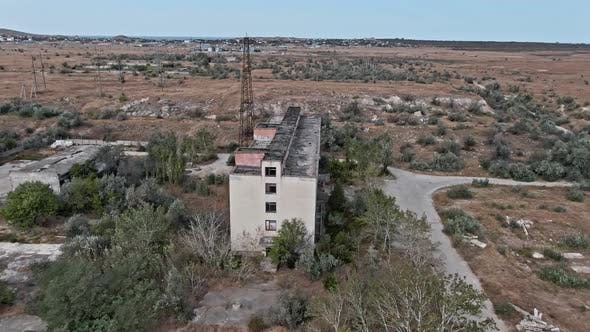 Thumbnail for AERIAL SHOT CRIMEA Near SHELKINO City AUGUST 2019 Old Abandoned Building Whis Signs of Destruction