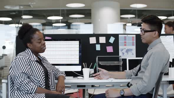 Cover Image for Office Workers Chatting at Desk